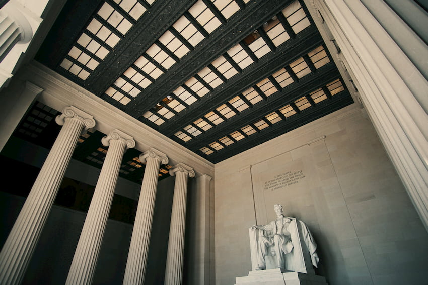 a grand view of the Lincoln memorial statue, surrounded by columns