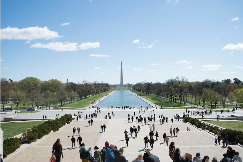 a view of the washington monument with the reflecting pool