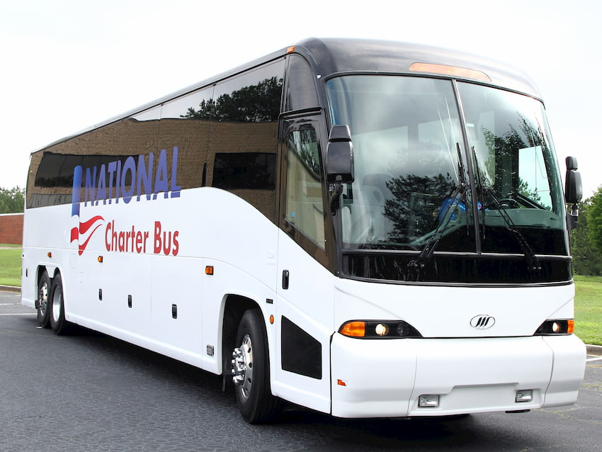 a bus from national charter bus begins its trip to d.c.