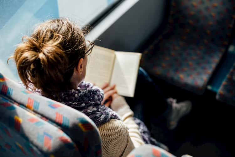 Woman reading in bus