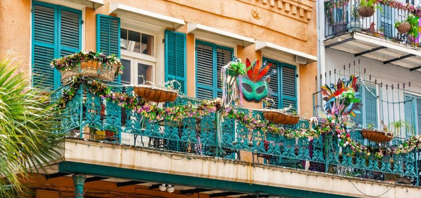 mardi gras masks hanging from balconies in new orleans