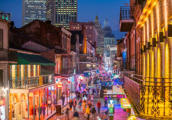 nighttime in the french quarter with people in the streets