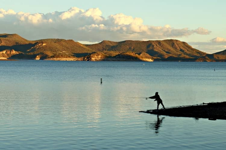 A person fishing on Lake Pleasant in Phoenix