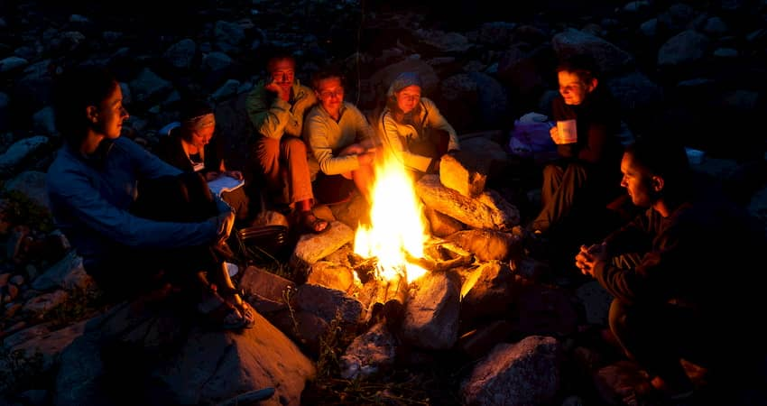 A group of campers around a campfire