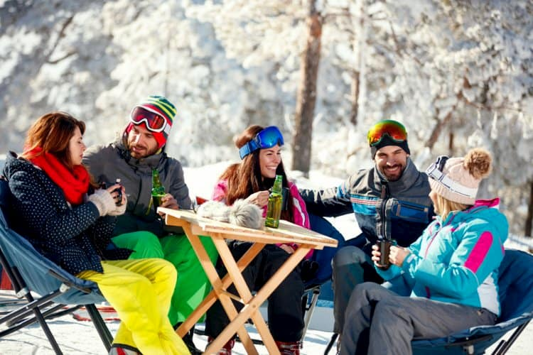 People drinking and laughing after skiing