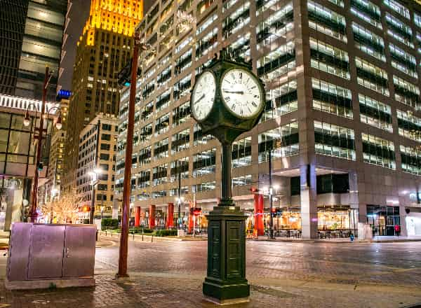Historic City Clock at the Intersection of Main Street and Texas Street at Night