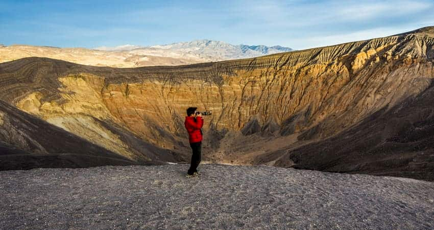 Man taking photograph in Death Valley