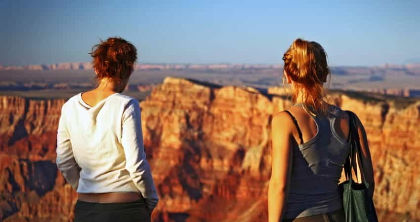 two women looking over a canyon after a hike
