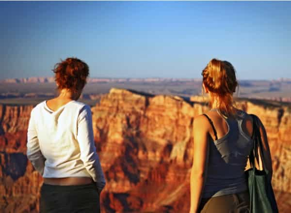 two women hiking at a canyon