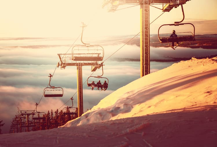 Ski slopes and ski lift at sunset
