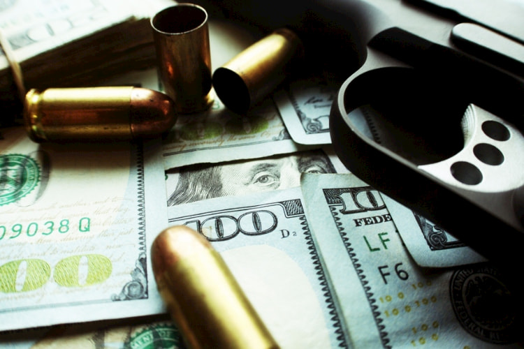 money, gun and bullet