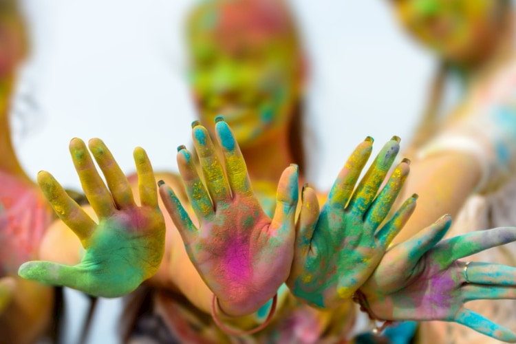 people with paint on their hands