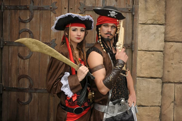 two people dressed in pirate costumes