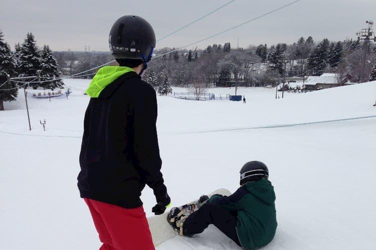 Two boys snowboarding at Villa Olivia