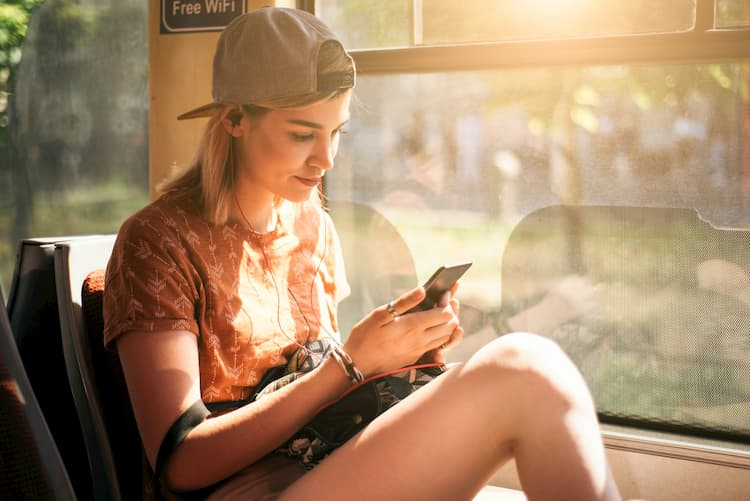 Young woman on phone on bus