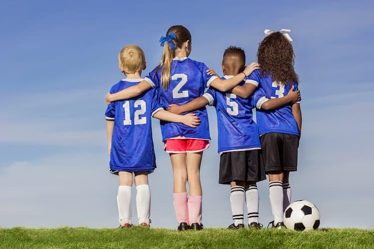 Kids in soccer uniforms