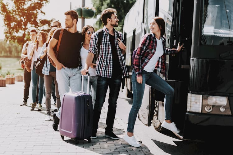 People boarding bus