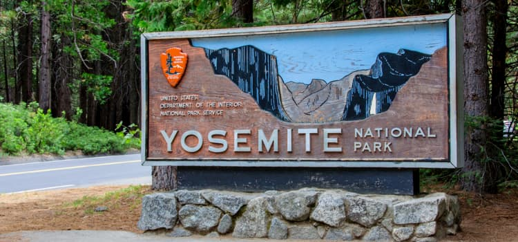 an entry sign for yosemite national park