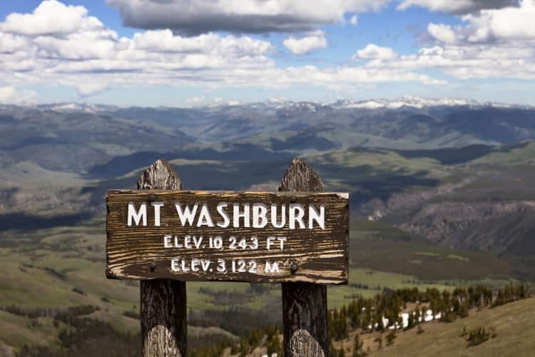 A wooden Mount Washburn sign overlooking Yellowstone National Park