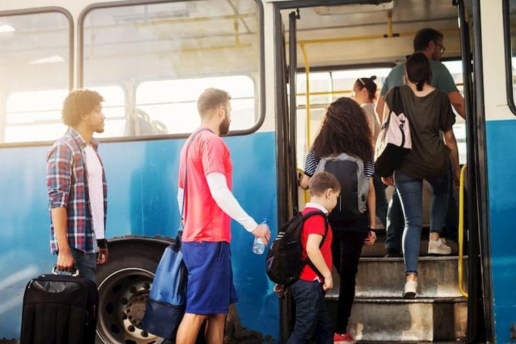 People climbing onto tour bus