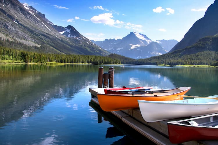 Canoes by lake in Glacier National Park