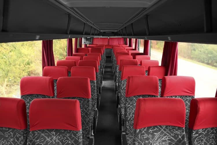 Charter bus with gray and red seats