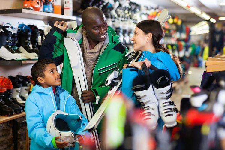 Family buying ski equipment together