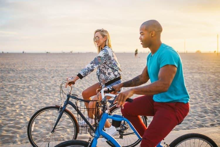 Couple riding bikes at Santa Monica Beach