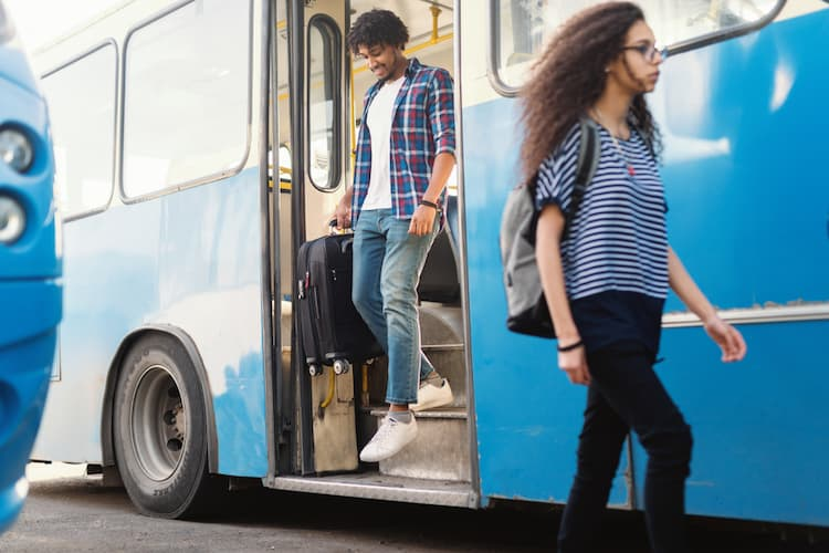 People climbing off bus