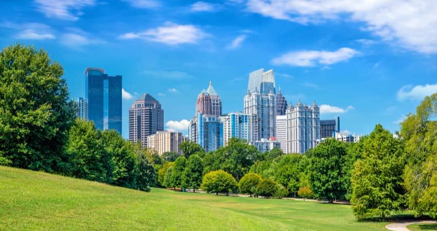 The Atlanta skyline behind trees in Piedmont Park