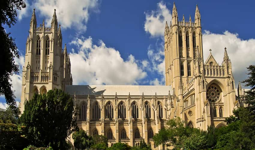 The outside of the Washington National Cathedral surrounded by trees