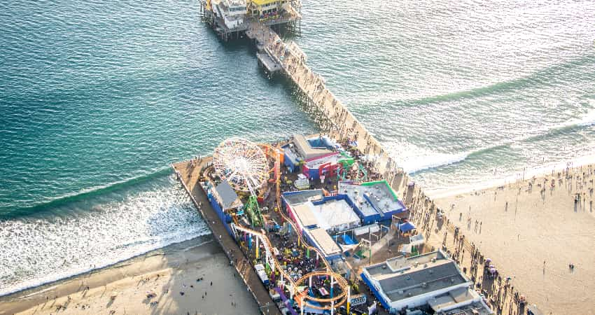 Areial view of the Santa Monica Pier and Boardwalk full of people