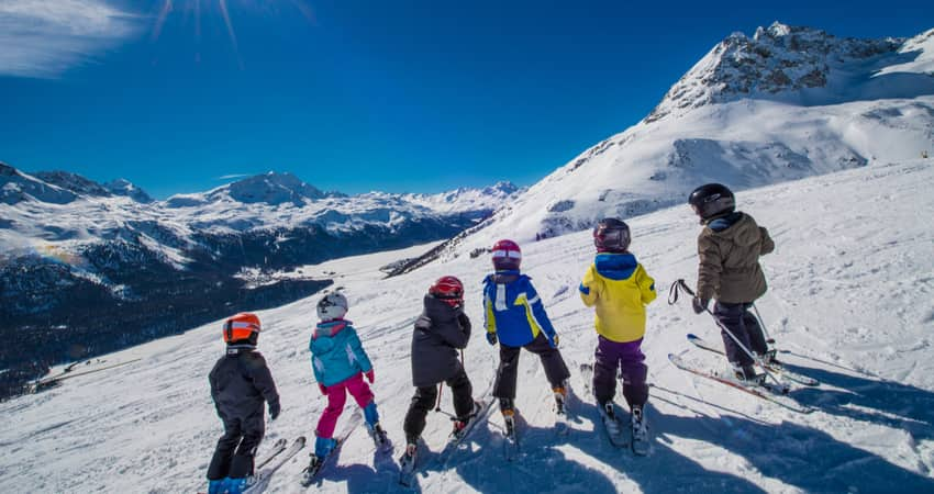 A group of children skiing