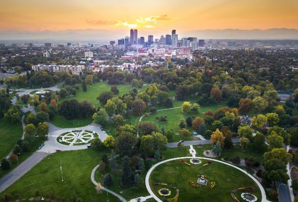 an aerial view of denver's skyline and green space