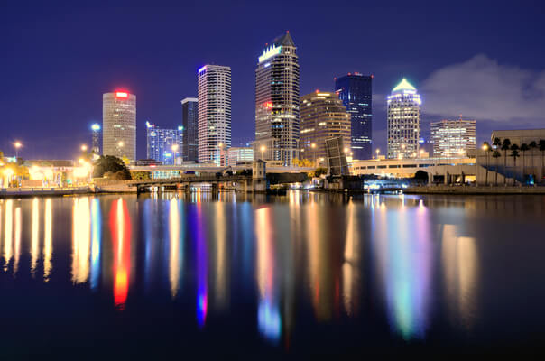 the tampa skyline from the bay, with the building lights reflecting on the water
