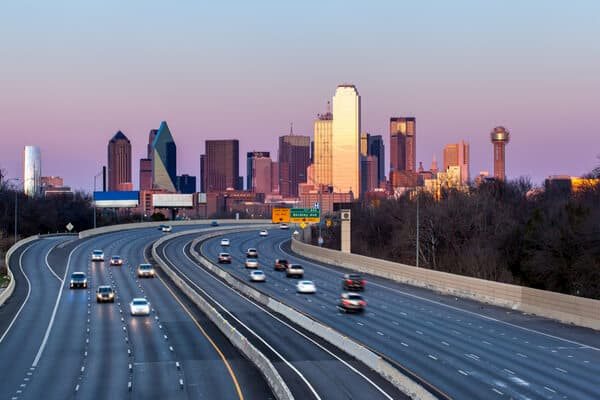 cars on a highway that leads into dallas