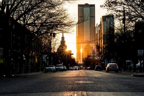 a cobblestone dallas street at sunset