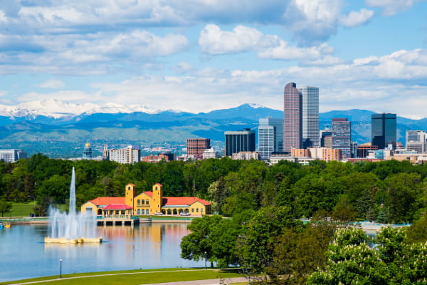 the denver skyline with the mountains in the background