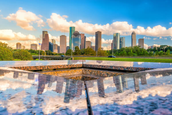 a granite sculpture with houston in the background