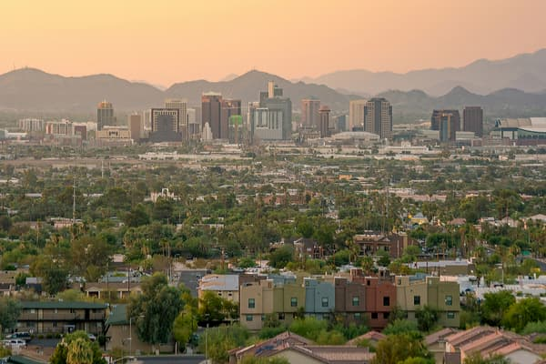 an aerial view of the phoenix skyline and the surrounding mountains