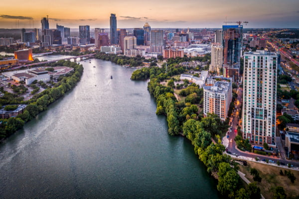 An aerial view of the Colorado River and part of Downtown Austin.