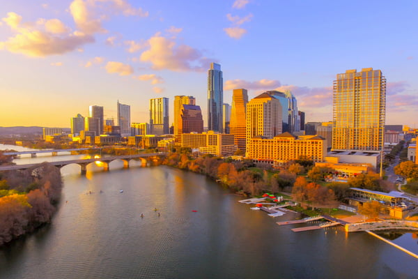 The Downtown Austin skyline and the Colorado River at sunset