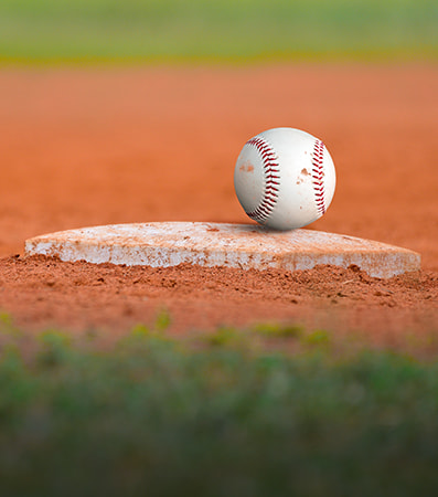 A baseball resting on a base platform before a game