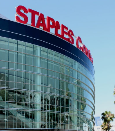 The external glass facade of the Staples Center