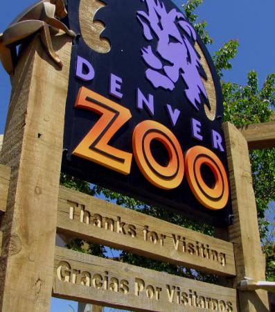 A wooden Denver Zoo sign