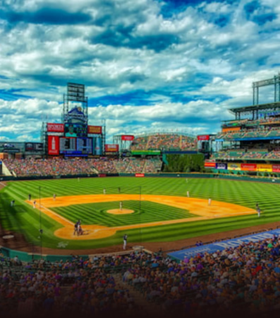 An aerial view of Coors Field on a cloudy day