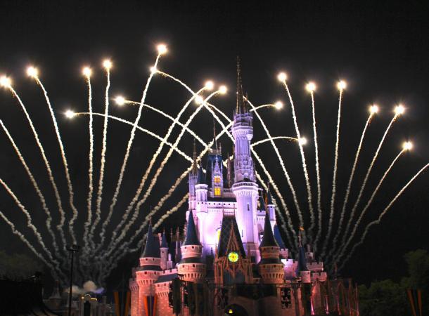 Fireworks illuminate the night behind the castle at Disney World in Orlando