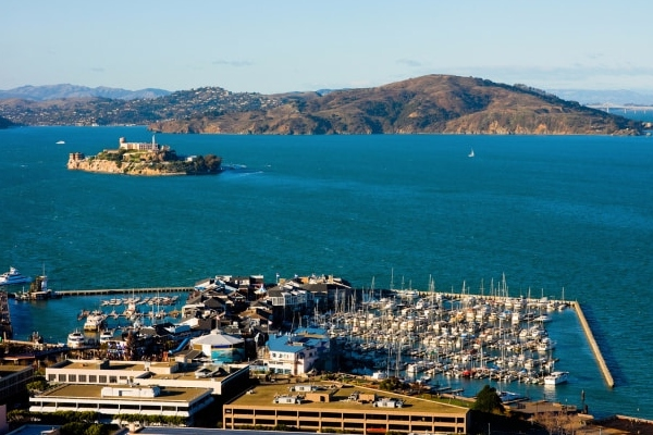 Aerial view of Pier 39 in San Francisco, the bay and Alcatraz Island visible in the background