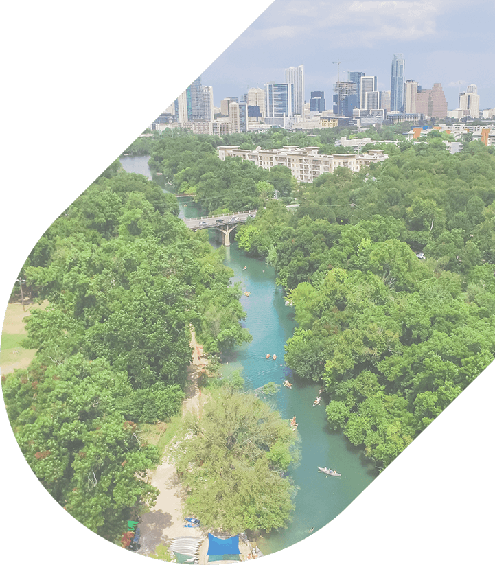 An aerial view of the lush green trees at Zilker Metropolitan Park