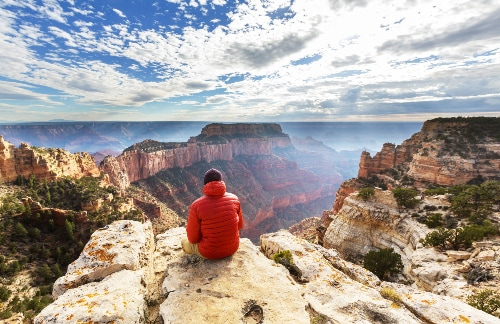 hiker-in-a-red-hoodie-admiring-the-grand-canyon